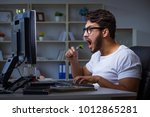 young man staying late in... | Shutterstock . vector #1012865281