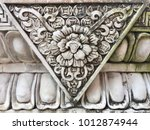 Stone Carving On Based Pole Of...