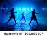 girls dancing on the water with ... | Shutterstock . vector #1012889107