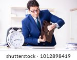 businessman in rush trying to... | Shutterstock . vector #1012898419