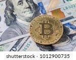gold bitcoin on hundred dollars ... | Shutterstock . vector #1012900735