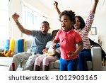 african family spending time... | Shutterstock . vector #1012903165