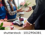 buying a bouquet for beloved... | Shutterstock . vector #1012906381
