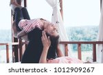 happy asian child girl laughing ... | Shutterstock . vector #1012909267
