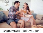 beautiful young couple drinking ... | Shutterstock . vector #1012910404
