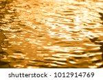 golden water surface splashing... | Shutterstock . vector #1012914769