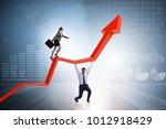 business people in economic... | Shutterstock . vector #1012918429