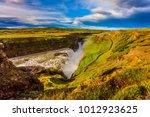 grand golden waterfall on the... | Shutterstock . vector #1012923625