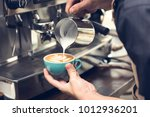professional barista pouring... | Shutterstock . vector #1012936201