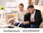 Small photo of Couple arguing about money at home. Problems in relationship