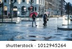 Turin, Italy. February 4, 2017. People on the streets in a rainy day - stock photo