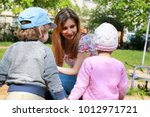 mom talks to the kids twins and ...   Shutterstock . vector #1012971721