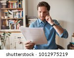 young man sitting at a table in ...   Shutterstock . vector #1012975219