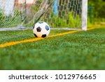 soccer ball on artificial grass | Shutterstock . vector #1012976665