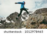 travel man running in mountains ... | Shutterstock . vector #1012978465