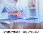side view of hand using tablet... | Shutterstock . vector #1012980364