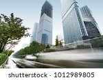 heavy rain in the streets and... | Shutterstock . vector #1012989805