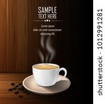cup of coffee with coffee beans ... | Shutterstock .eps vector #1012991281