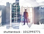 back view of young businessman... | Shutterstock . vector #1012993771