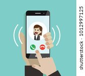 incoming call. human hand... | Shutterstock .eps vector #1012997125