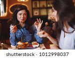 two young women at a lunch in a ... | Shutterstock . vector #1012998037