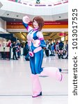 Small photo of Birmingham, UK - November 19, 2017: Cosplayer dressed as Ochaco Uraraka from the manga and anime My Hero Academia at Birmingham MCM Comic Con.