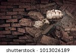 hand breaking through the wall. ... | Shutterstock . vector #1013026189
