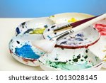 artists flower shaped style... | Shutterstock . vector #1013028145
