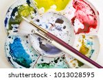 artists flower shaped style... | Shutterstock . vector #1013028595