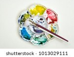 artists flower shaped style... | Shutterstock . vector #1013029111