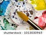 artists flower shaped style... | Shutterstock . vector #1013030965