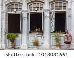 colonial old building facade in ... | Shutterstock . vector #1013031661