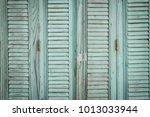 wooden painted shutters | Shutterstock . vector #1013033944