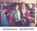 young couple demonstrates the... | Shutterstock . vector #1013037355
