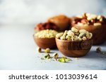 Pistachios Nuts In Wooden Bowl...