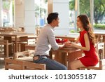 loving young couple holding... | Shutterstock . vector #1013055187