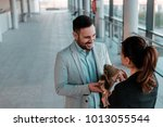 smiling business man giving... | Shutterstock . vector #1013055544