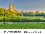 at the lake in central park ... | Shutterstock . vector #1013064721