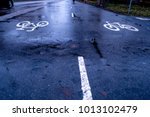 Wet Bicycle Path Ways In A Cit...