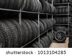 rack with variety of car tires... | Shutterstock . vector #1013104285