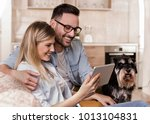 young happy couple sitting on... | Shutterstock . vector #1013104831
