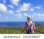 female looking out at the... | Shutterstock . vector #1013108047