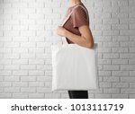 woman with cotton bag near... | Shutterstock . vector #1013111719
