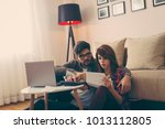 young couple managing their... | Shutterstock . vector #1013112805