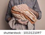 rustic crusty loaf of bread in... | Shutterstock . vector #1013121097