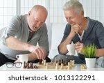 senior men  playing chess | Shutterstock . vector #1013122291