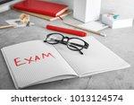 word exam written in notebook...   Shutterstock . vector #1013124574
