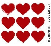 set of red hearts in grunge... | Shutterstock . vector #1013125834