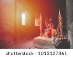 ancient statue of a monk in the ... | Shutterstock . vector #1013127361