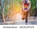 healthy woman doing exercises... | Shutterstock . vector #1013129125